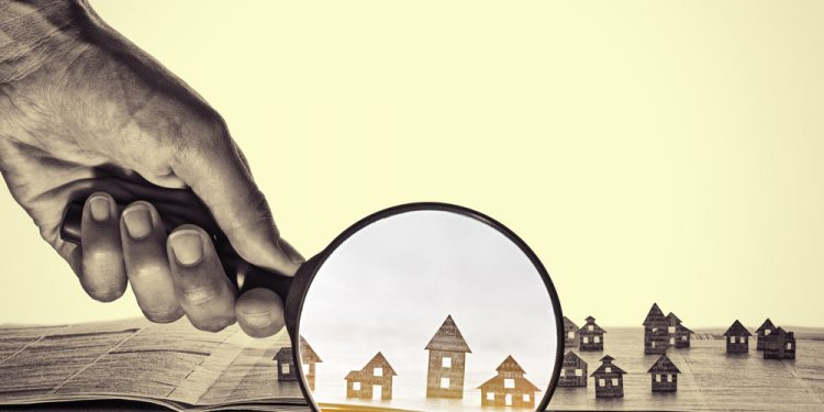 Illustration of magnifying glass on house