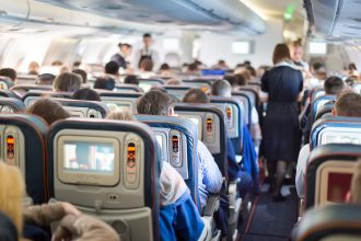 airplan cabin economy seats with people