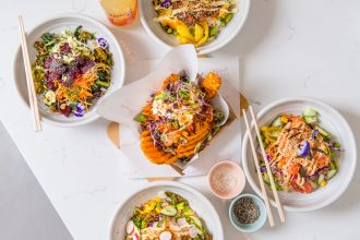 areal view of table with poke bowls