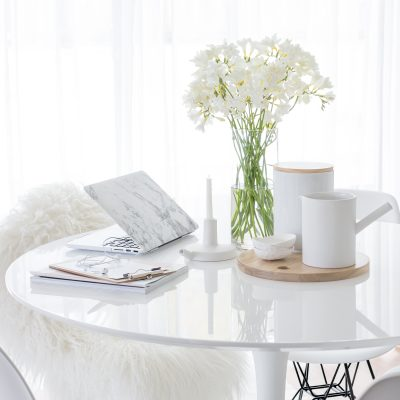 white table with white accessories and flowers