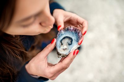 girl eating oyster