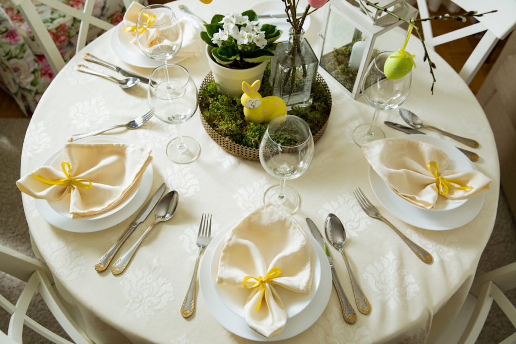 Easter Dining Table with Moss decorations. Image by Aleksandra Suzi via Shutterstock