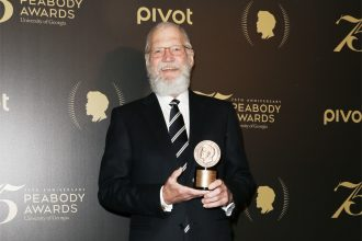 david letterman holding peabody award