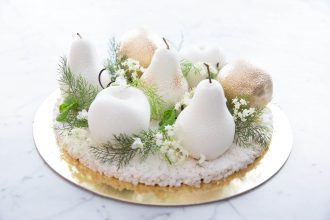 The KOI White Christmas Cake - Xmas cherry, lemon and pear fruits on top of a rice bubble base. Image: Supplied