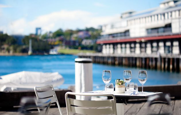 Outdoor setting with Walsh Bay in the background. Image: Supplied