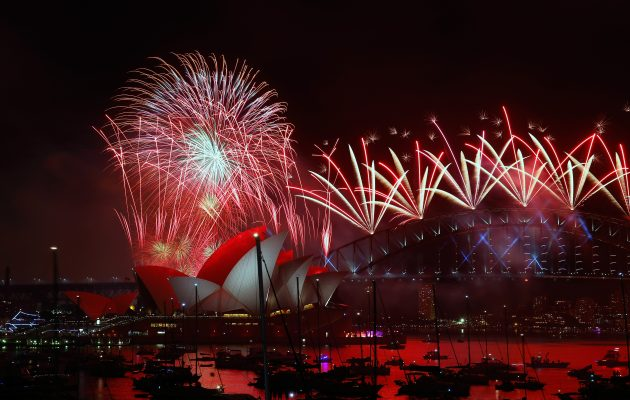 Fireworks explode over the Sydney Harbour Bridge. Image: Zak Kaczmarek