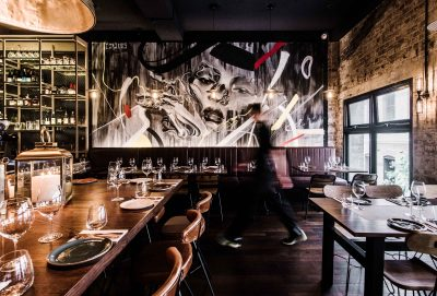 Waiter walks through dining room at Eastside Kitchen and Bar. Image: Supplied