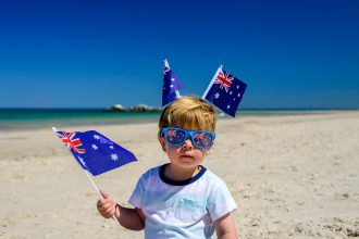 Kid poses for camera in Australia Day Paraphernalia. Image: amophoto_au