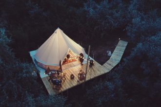 Glamping tent. Photographed by Moise Sebastian. Image via Shutterstock