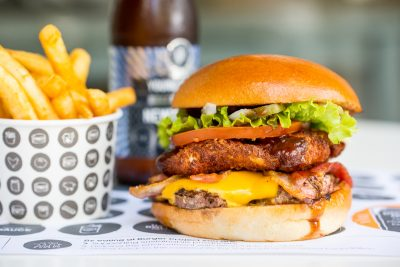 Limited-edition burger 'Barnyard Stack' along with Young Henrys' the Newtowner. Image: Supplied