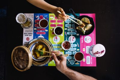 Couple uses chopsticks to eat food. Image: Supplied