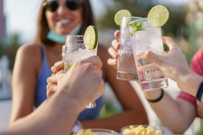 Friends cheers cocktails. Image by Giuseppe Lombardo via Shutterstock.