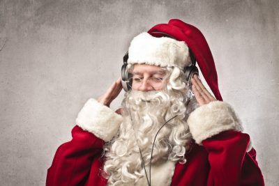 Santa Claus listening to msuic. Image: Ollyy / Shutterstock