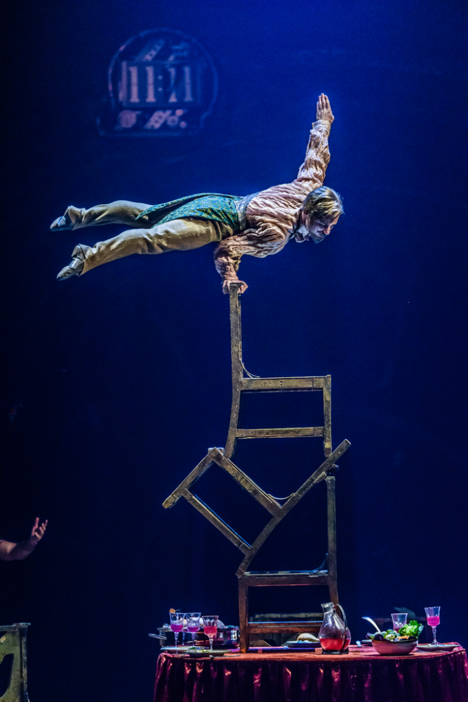 The wacky dinner party trick. Image: Martin Girard / shootstudio.ca Costumes: Philippe Guillotel © 2014 Cirque du Soleil