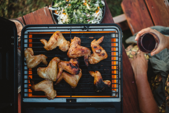 Grilled Whisky Chicken Wings from WILD: Adventure Cookbook by Sarah Glover. Image supplied