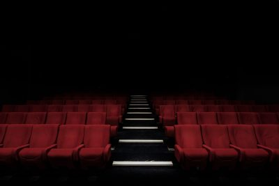 Cinema seats. Photographed by Felix Mooneeram. Image via Unsplash.