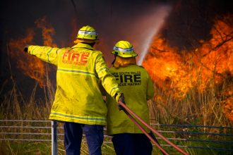 NSW firefighters battling a bushfire. Image: Karl Hofman / Shutterstock