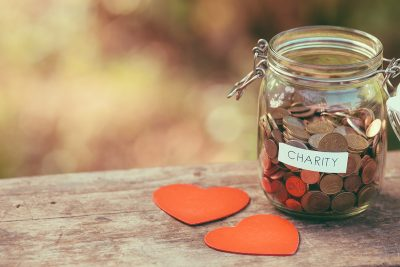 Charity donation jar. Image via shutterstock