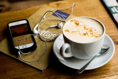 Phone and Coffee on Table.