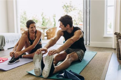 At home exercising. Photographed by Jacob Lund. Image via Shutterstock.