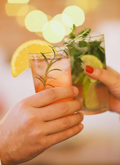 Cocktail cheers. Photographed by Dasha Petrenko. Image via Shutterstock