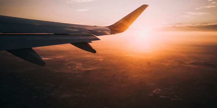 Plane in sunset. Photographed by Nils Nedel. Image via Unsplash.