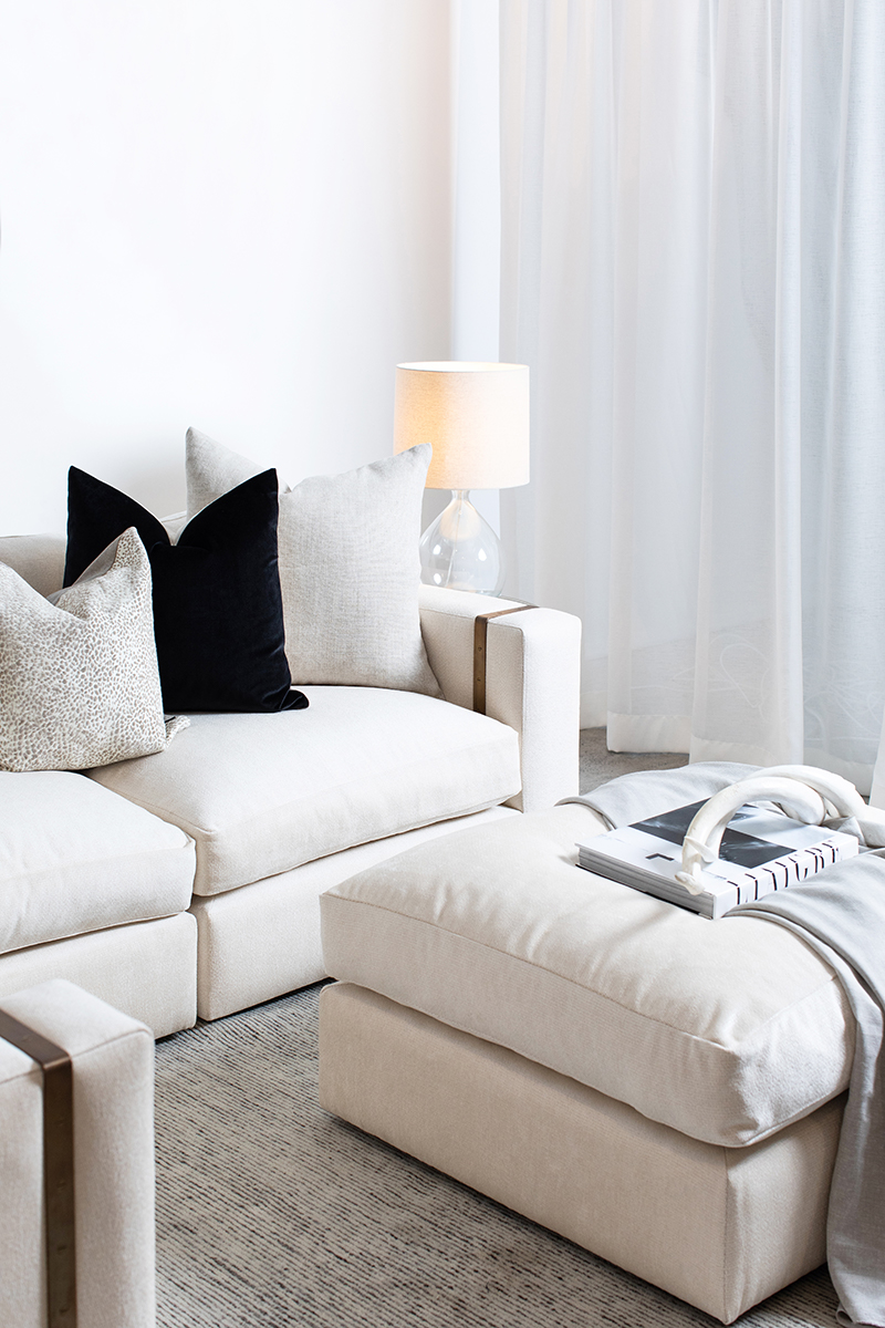 Crafted Furniture white sofa and ottoman. Image supplied via Crafted Furniture