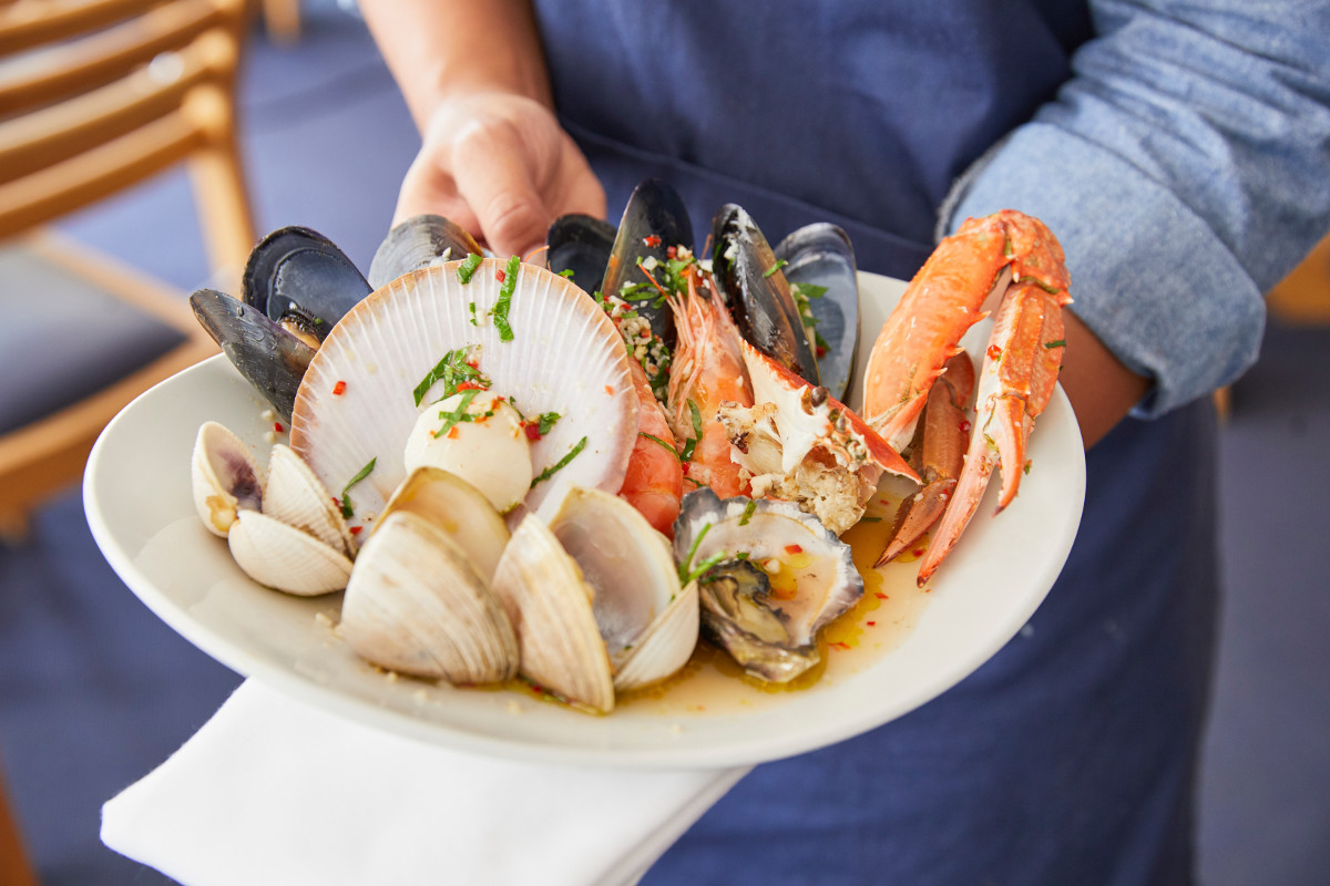 Warm Shellfish with Parsley, Chilli, Olive Oil, Garlic and Lemon Juice dish available at Bannisters by the Sea, Mollymook Beach. Image: Destination NSW
