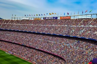 Camp Nou stadium. Photographed by Vangelis Kovi. Image via Unsplash