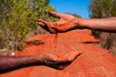 Red sands Aboriginal Culture. Photographed by SBourges. Image via Shutterstock