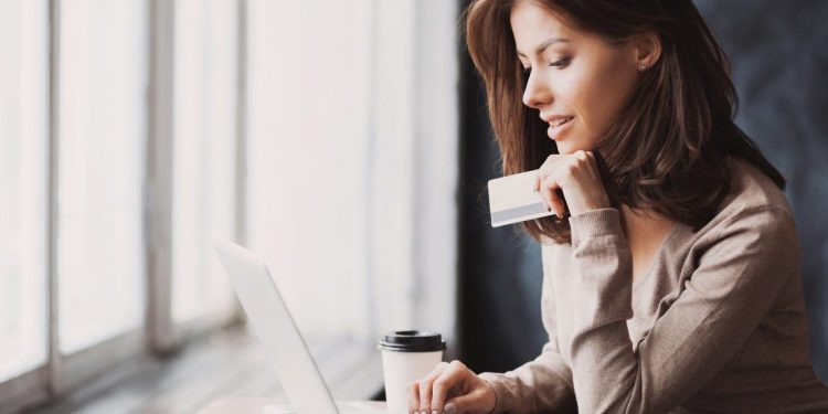 Woman online shopping. Photographed by Kite_rin. Image via Shutterstock.