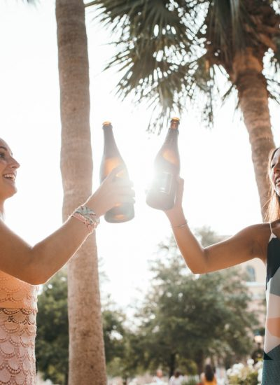 Girls drinking wine in summer. Photographed by KAL VISUALS. Image via Unsplash