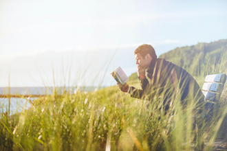 Man reading book. Photo by Ben White. Image via Unsplash