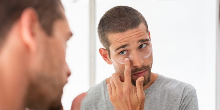 Man applying skin care routine. Photographed by Rido. Sourced via Shutterstock