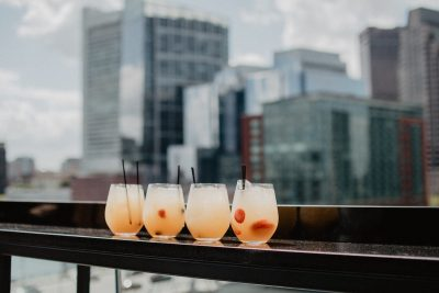 Rooftop drinks. Photographed by Kelly Sikkema. Image via Unsplash