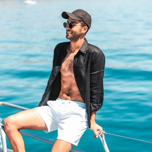 Vacay Swim Black Cap Shirt and White Shorts. Image supplied